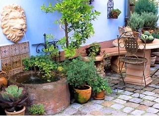 Mediterranean garden room with terracotta ornaments