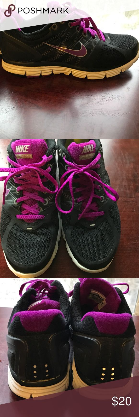 Women's Nike Lunarglide 2 shoes sizes 7.5 Black and purple women's Nike Lunarglide 2 shoes. Very comfortable shoes. In great condition Nike Shoes Athletic Shoes