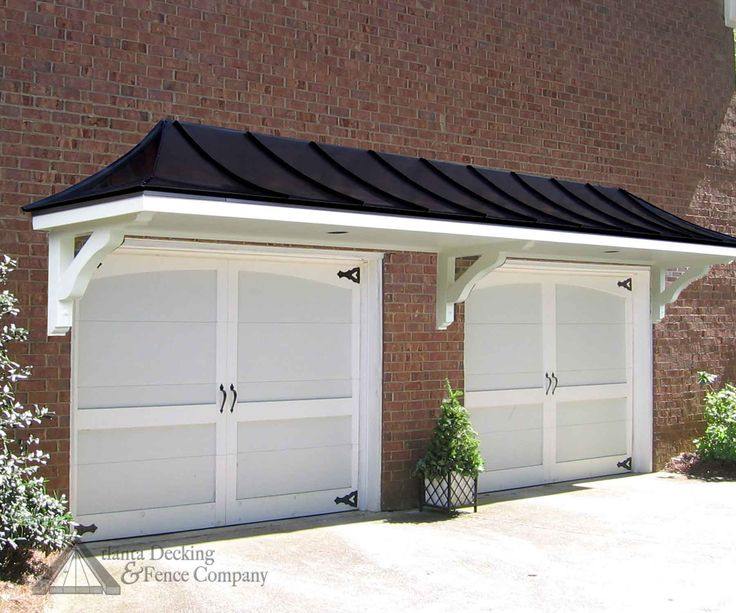 Roof pergola over garage doors from atlanta decking and fence company