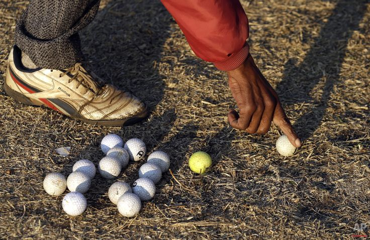 Wynand Morudu, points to a golf ball during a game at a park in Katlehong township, east of Johannesburg, South Africa, Thursday, July 16, 2015. (AP Photo/Themba Hadebe)