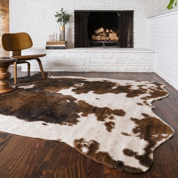 Rustic charm meets contemporary chic in this huge and handsome faux-fur rug. Expertly crafted from premium synthetic fibers, this commanding accent piece incorporates a unique beige and brown animal p