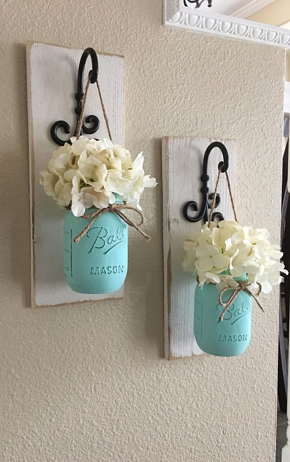 These rustic country style mason jar sconces are the perfect touch to your home decor. They bring warmth and beauty to any room. This listing is for 2 Sconces so for each quantity of one at checkout you are ordering one set of 2.  {{{{{JARS ARE PAINTED IN MINTY TEAL}}}}}  Scroll through the listing to see your sconce finish/flower/jar paint color options.  The Sconce pictured is done in Antique White the Jars are done in Minty Teal.  (Flowers are optional)  {PLEASE LEAVE ME A NOTE W...