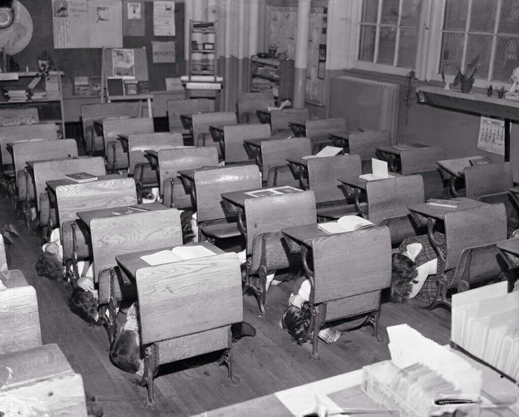 """Children practice the """"Duck and Cover"""" drill, to protect themselves against the effects of a nuclear explosion, 1950s."""