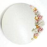 How to Decorate a Mirror with Flower  These are dipped in Plaster of Paris and allowed to dry, then painted.