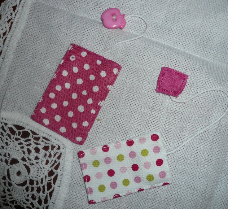 Play tea bags.  these are my first attempt.  I have decided the fabric tags are the best.  As soon as I have time I will be making some more.  Little girls will just <3 these for their tea parties.  http://www.facebook.com/MamasLoveChildrensClothingAndAccessories