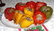 Wiki: Dolma: Family of stuffed vegetable dishes common in the Middle East & surrounding regions incl. Balkans, Caucasus, Russia, & Central Asia. Tomato, pepper, onion, zucchini, eggplant, & garlic are stuffed. Meat dolmas are served warm w/tahini, egg-lemon, or garlic yogurt sauce; Meatless are served cold. Ripieni (stuffed) are Italian stuffed vegetables. Grape or cabbage leaves wrapped around a filling are also called dolma, yaprak dolma (leaf dolma) or sarma - Wikipedia