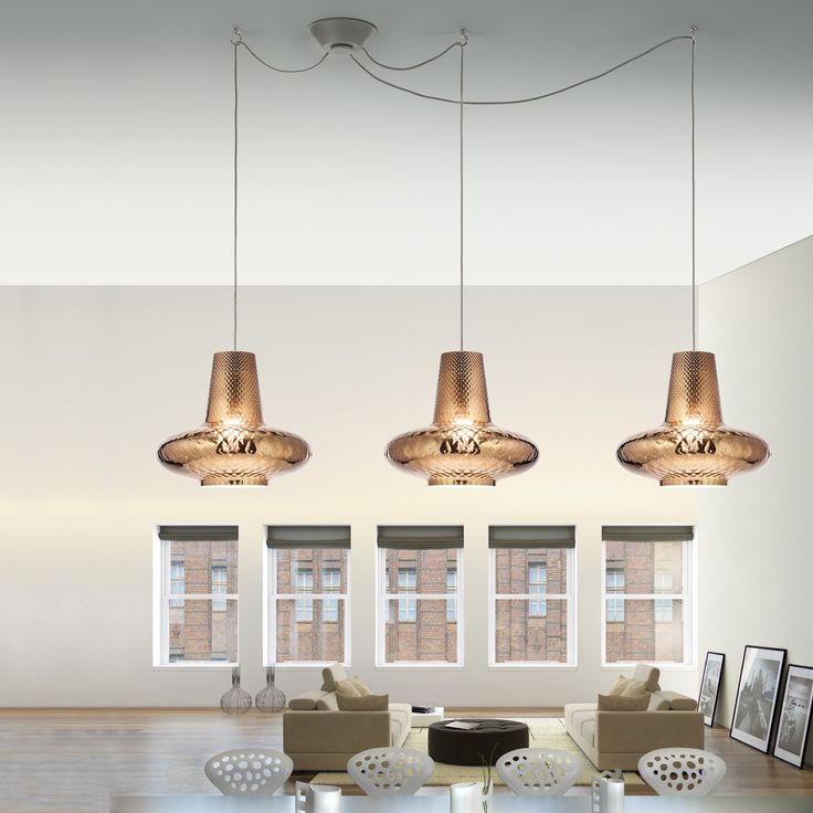 Suspended from a round, grey canopy are three shades handcrafted from mouth-blown glass that feature bright, metallic finishes. http://www.ylighting.com/federicodemajo-romeo-and-giulietta-metallic-3-light-multipoint-pendant-light.html