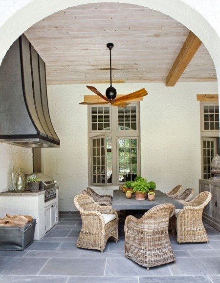Love this outdoor space- painted brick exterior walls, slate tile, beaded board ceiling