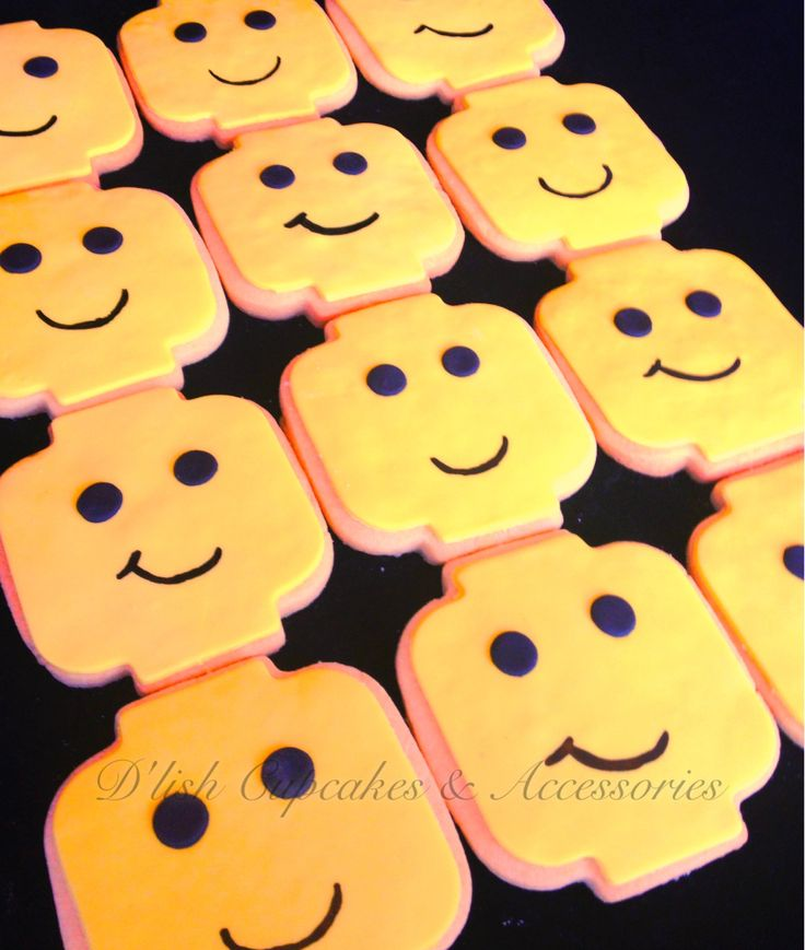 Lego head cookies. Lego head cookie cutter available at www.dlishcookies.com