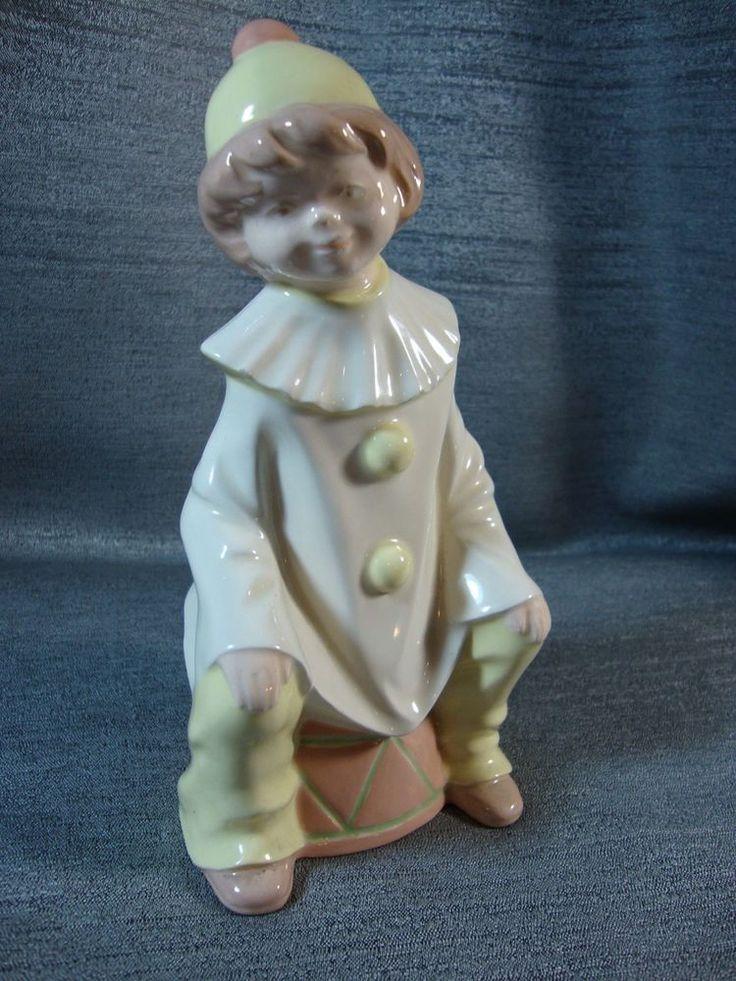 Porcelain Boy Sitting on Drum Harlequin Sign by Jean