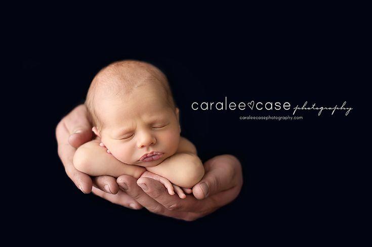 Black background newborn photography
