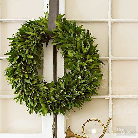 Yes, the wreath is important, but sometimes, it's what you pair with the wreath that makes a statement. Here an unadorned leafy wreath is supported by a pair of old windows creating a gorgeous combination that's both vintage and festive./