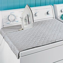 This makes way more sense than dragging an ironing board out:    Quilted ironing board with magnets for the top of the dryer! -- no more wrestling with the ironing board!