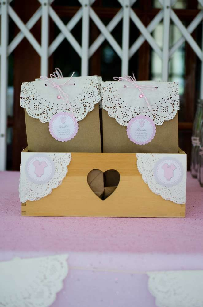 Pink and white baby shower party paper bag favors! See more party planning ideas at CatchMyParty.com!