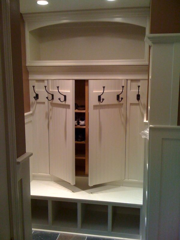 Hidden shoe rack storage behind hooks in mudroom~COOL, COOL, COOL!