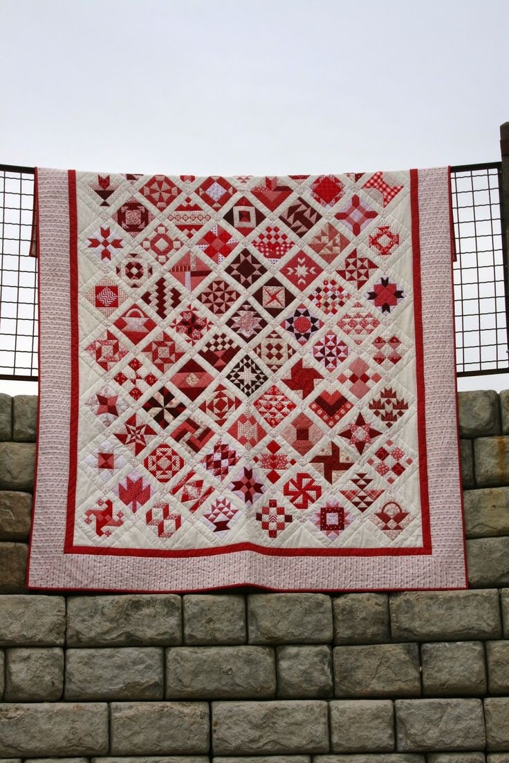 Finished Red and White Farmer's Wife quilt from A Little Bit Biased. Hand-quilted.