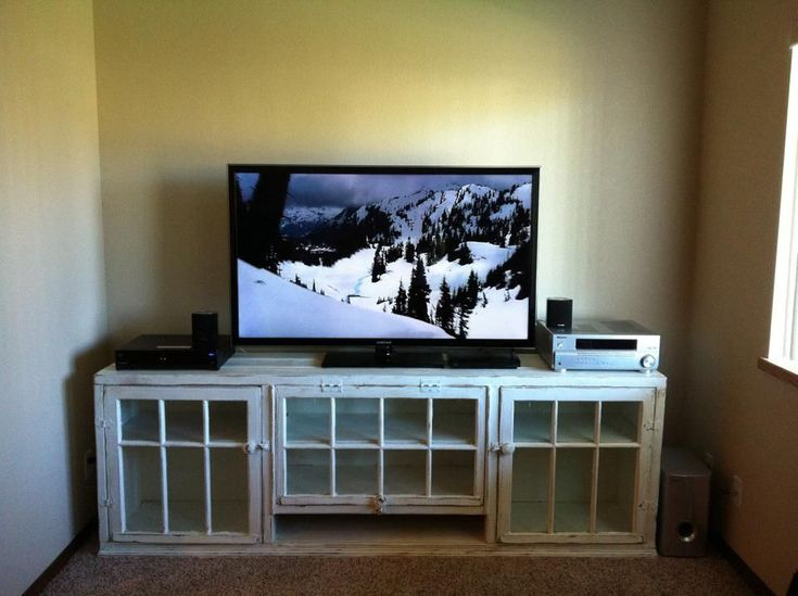 Custom made rustic tv stand. Made from old barn windows.