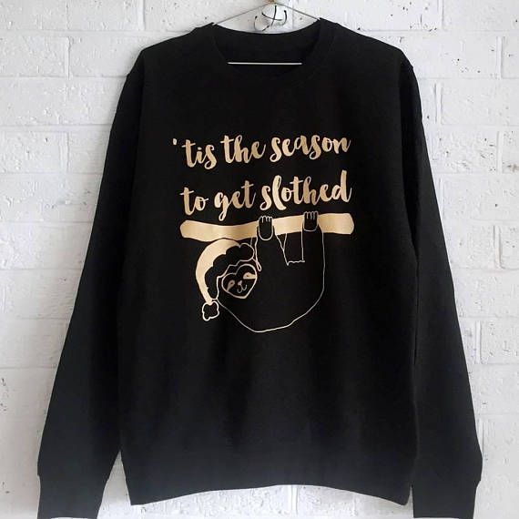 This funny Christmas jumper reads 'Tis The Season To Get Slothed'