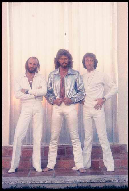 The Bee Gees -  looked the same throughout the 70's and 80's. This was the trios 5th number single in the UK. Also making them the first act to score a number 1 hit in three different decades (60s, 70s & 80s).
