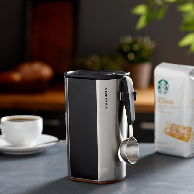 A stainless steel coffee canister with chalkboard to record coffee names or write messages.