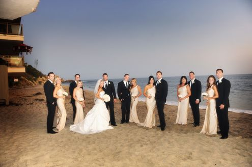 Wedding party- groomsmen with black suits and black ties, bridesmaids with long champagne dresses