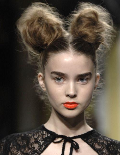 two messy buns. orange lips
