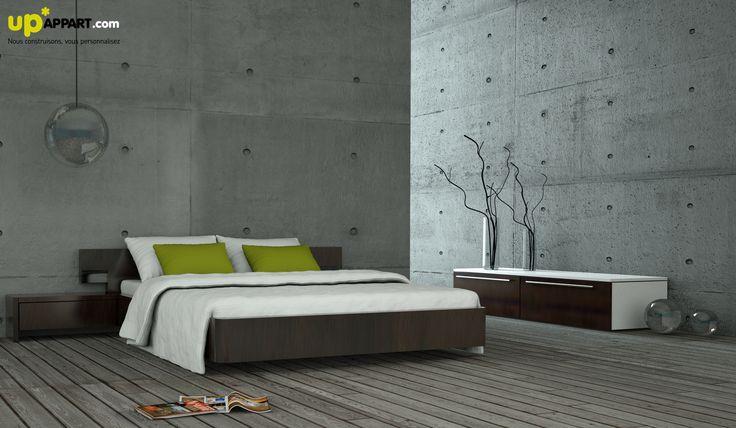 Une chambre design aux murs béton.