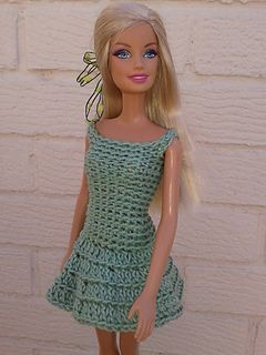 Barbies crochet dress. I honestly am not certain I like this one, but I find it very visually appealing anyway. I might make it and play with the stitches some.