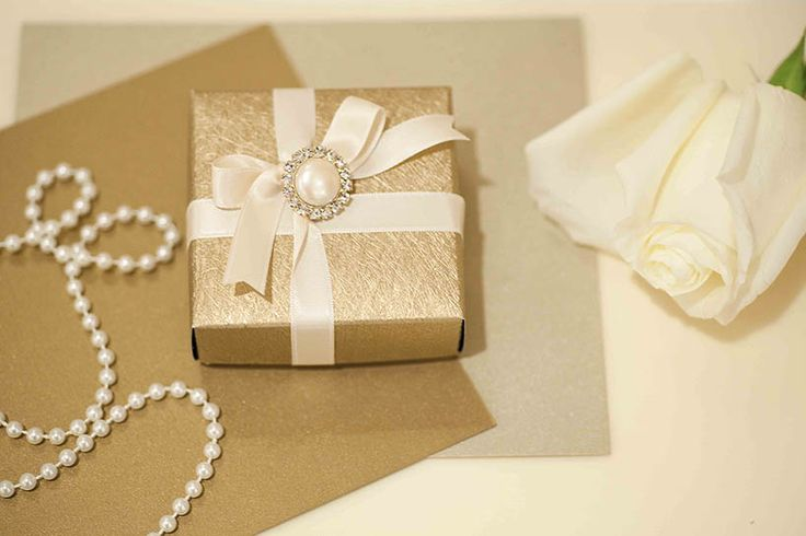 Gold and ivory wedding favors - By Mitheo Events