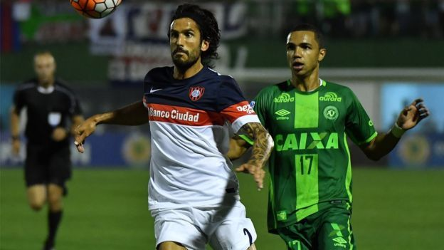 Marcos Angeleri of Brazil's Chapecoense, vies for the ball with Tiaguinho of Argentina's San Lorenzo, during their 2016 Copa Sudamericana semifinal second leg football match on 23 November