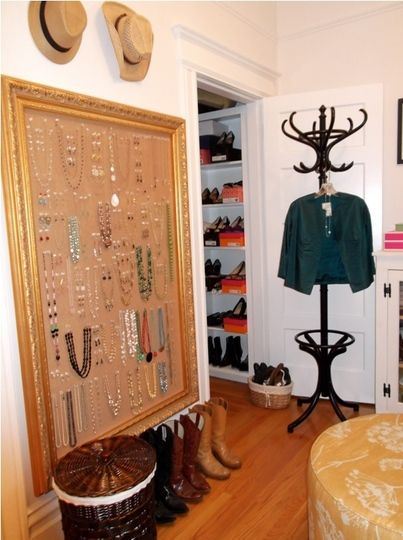 Love the idea of using cork board that is framed to display jewelry, but I think it would be even cuter if it was covered in burlap. Check out www.massivbrand.com line of burlap bulletin boards.