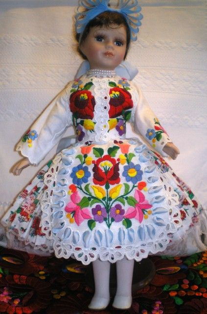 A little china doll dressed up in Kalocsa folkwear.