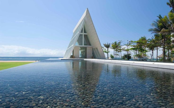 """<p>Conrads marble, glass, and steel<a rel=""""nofollow"""" href=""""http://www.conradbali.com/weddings.html""""> Infinity Chapel </a>is a striking triangle that floats effortlessly on the sea. Guestsand, of course, the bridal partyarrive by way of a white marble walkway that seems to hover just above the surrounding infinity pools. As many as 60 people can attend the ceremony, and even the most basic wedding package comes with contemporary floral arrangements, live musicians, a celebrant, and a…"""