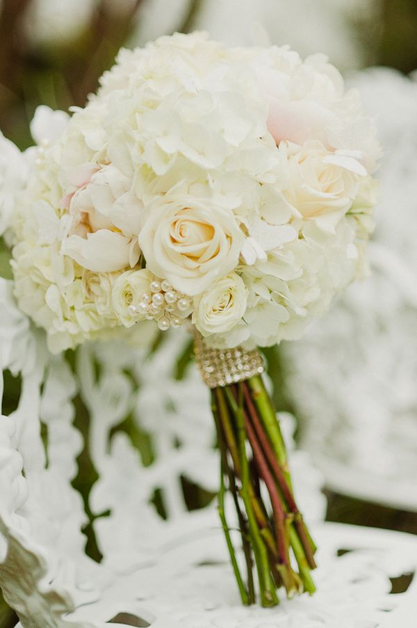 classic white wedding bouquet // photo by Merari Photography // http://ruffledblog.com/dominican-american-backyard-wedding