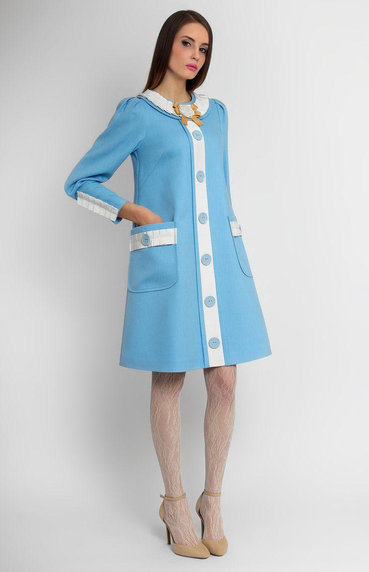 Round-neck long-sleeve A-shape true wool dress. Cotton ribbon trim. Idle button placket. Hidden back zip closure. Side patch pockets.
