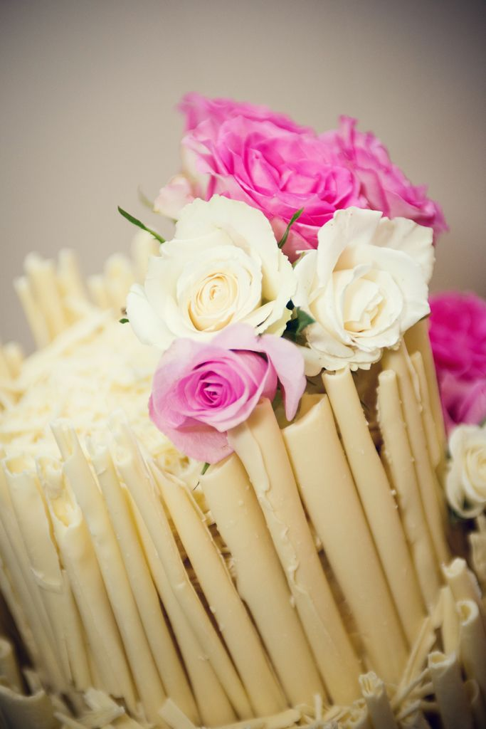 White chocolate wedding cake with fresh flowers.