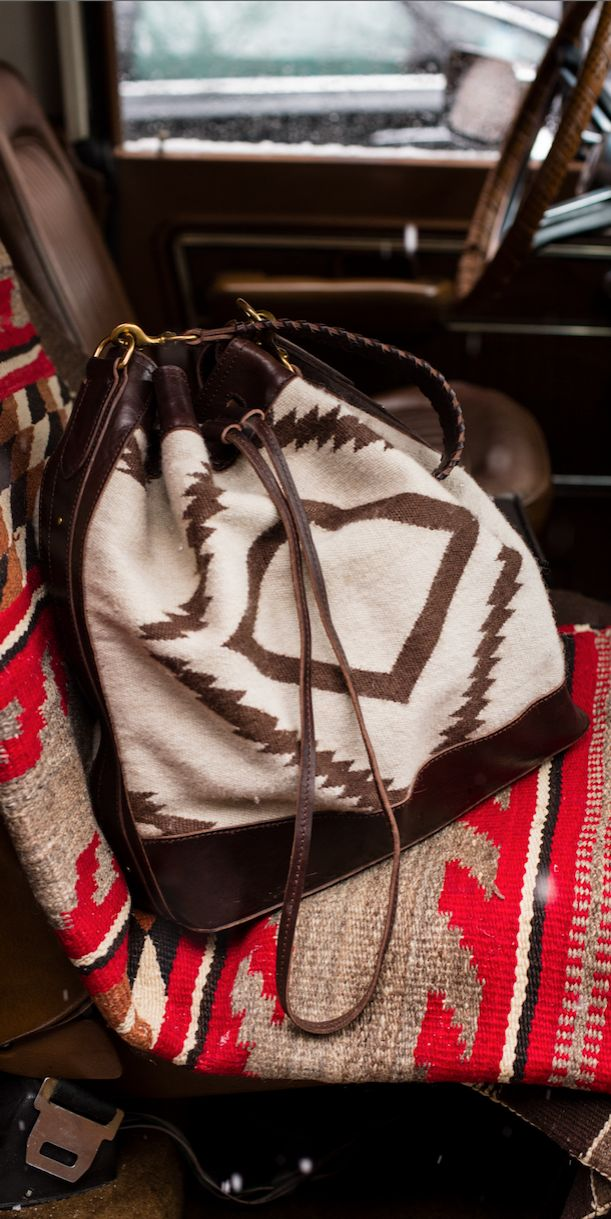 Southwestern-inspired drawstring bag: Detailed with textural whipstiching at the shoulder strap, this roomy style is a cool carryall for a day in the city or a weekend in the country.
