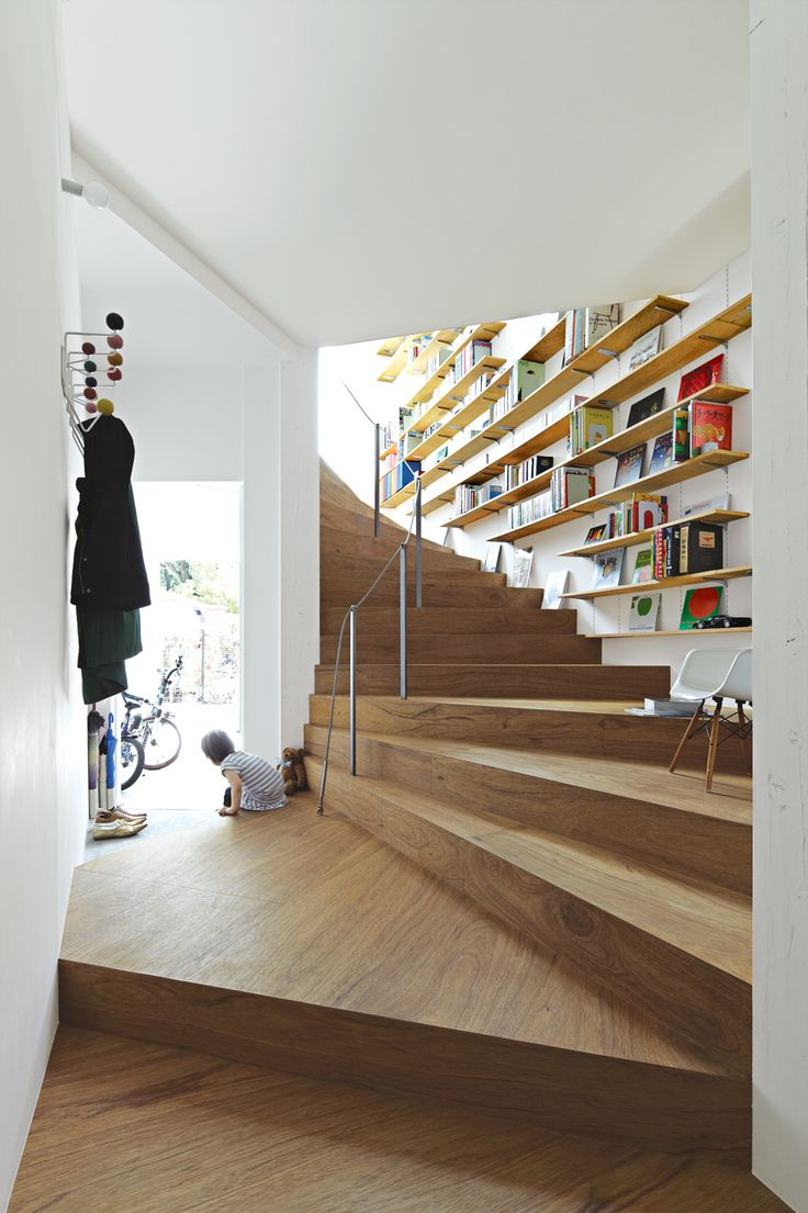coil-staircase- placement of the bookshelves is brilliant