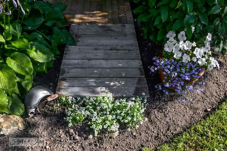 An easy 2 pallet garden walkway you can make in a quick afternoon!Funky Junk Interiors