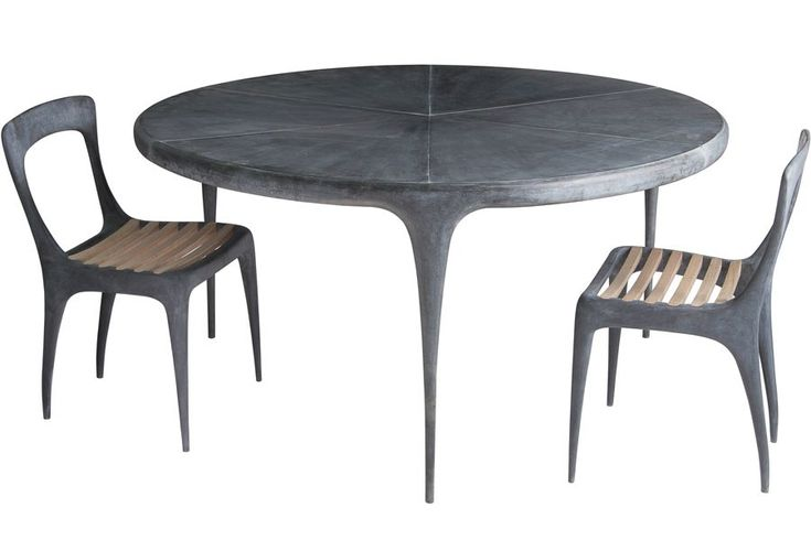 """Cast round dining table and teak-seated side chairs, all with a zinc-plated patina finish, by John Reeves Design; table comes with a metal (pictured) or teak top and measures 59"""" dia. x 29.5"""" h., chairs are 31"""" h. x 19.5"""" w., to the trade. reevesd.com, 011-84-90-301-2140"""