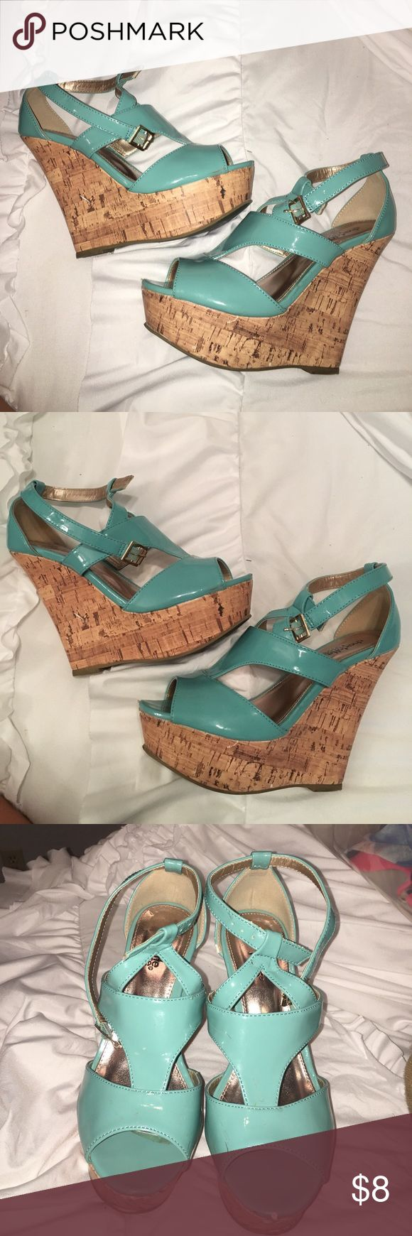 Turquoise Wedges Turquoise wedges from Charlotte Russe. Size 6. Worn before, noticeable scuffs on front of heels in cork area. Offers welcome. Shoes Wedges