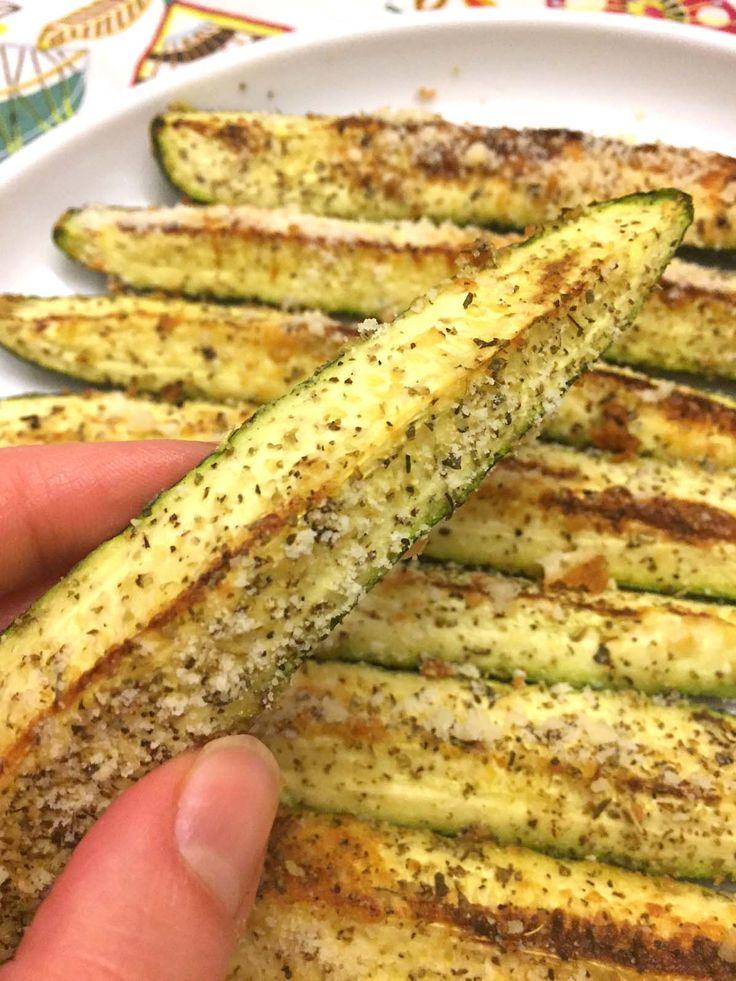 This Parmesan garlic zucchini is like zucchini on steroids! Rubbed with olive oil and garlic, sprinkled with Parmesan and oregano, then baked in the oven to golden brown perfection! This is the yummiest way to eat zucchini ever! Got some zucchini?  THIS is the way to eat it all up :) Parmesan garlic perfection - mmm.... If your perception of zucchini involves the soggy bland green mush, you absolutely need this recipe to turn it around.  This is the most perfectly seasoned, awesomely…