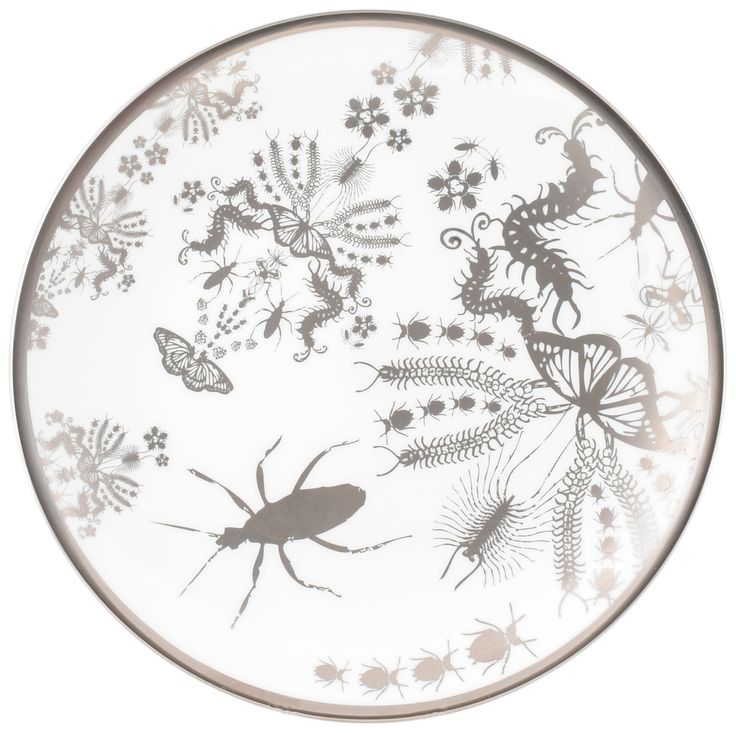 "8"" 'Entomo' Platinum Cake Plate – a beautiful plate displaying the 'Entomo design in its full glory. Entomo presents an array of some of the most important yet often misunderstood creatures on our planet. From gossamer wings of the butterfly to the architectural magnificence of the stag beetle, together a pattern of wonderment and delight. Designed by Monica Tsang. Handwash Only. Hand gilded platinum rim and details. Available in Platinum and Black. Made in Stoke-on-Trent, England. Fine Bone…"