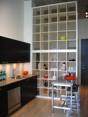 Architect Brian Kucharski used two Expedit bookcases from Ikea stacked on top of each other and secured to the wall.