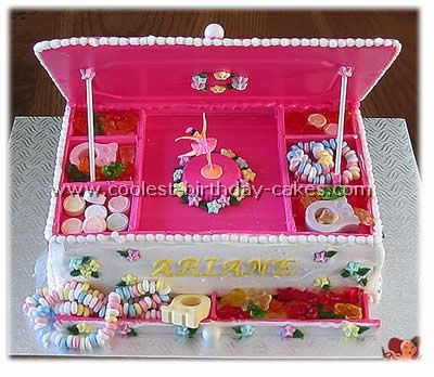 Jewelry box cake w/candy jewelry.  I think this would require major patience, but the end result is adorable!