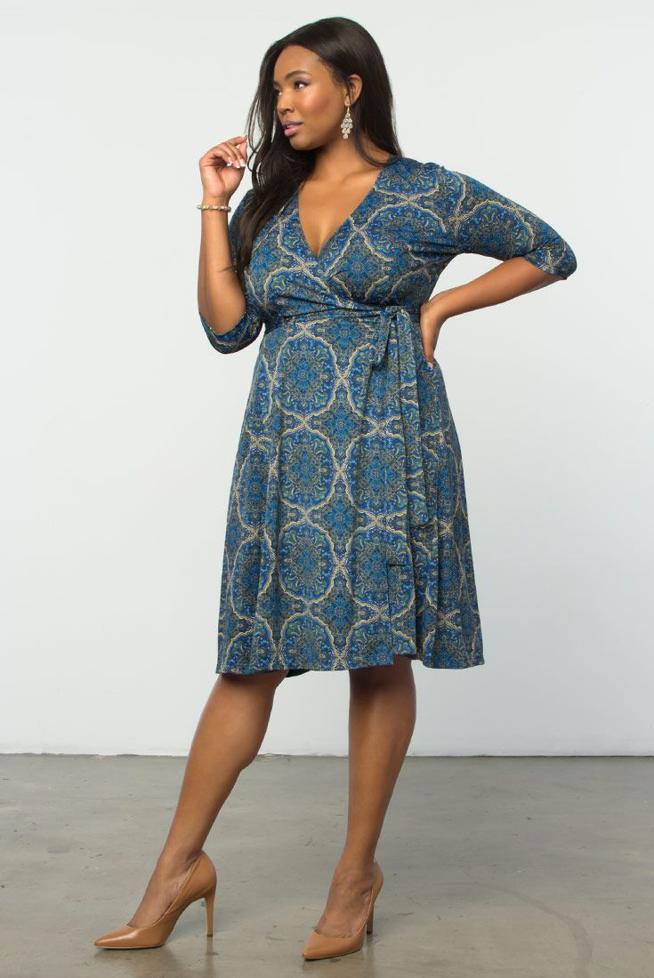 Our plus size Essential Wrap Dress gets updated in a unique medallion print. Same classic style that flatters every curve. Shop our entire made in the USA collection online at www.kiyonna.com.