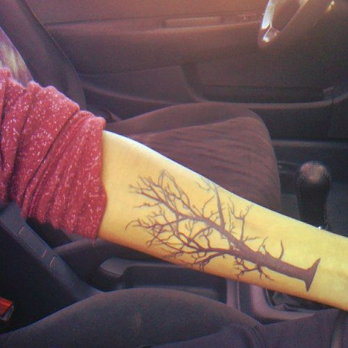 tree tattoo on arm. Missing the roots!!!