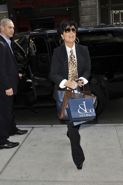 Kris Jenner stepped out in NYC wearing a polished pinstripe suit with a playful leopard print tie. | See more about Kris Jenner, Jenners and Animal Prints.