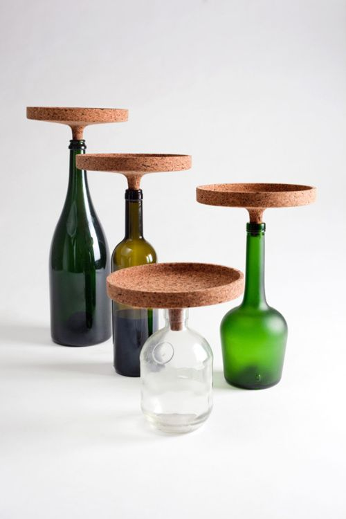 Wine bottles repurposed as serving pieces with cork tops.