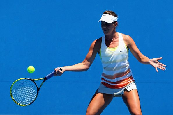 Michelle Larcher De Brito of Portugal plays forehand her first round match against Ekaterina Makarova of Russia during day one of the 2013 Australian Open at Melbourne Park on January 14, 2013 in Melbourne, Australia.
